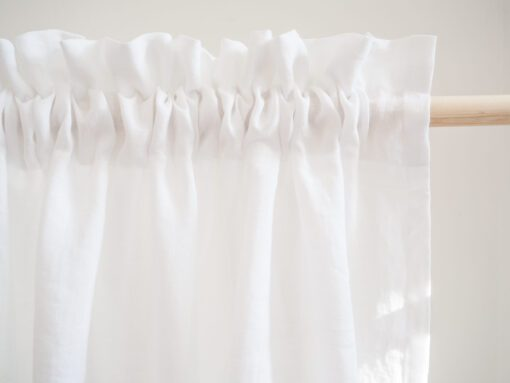 White curtains with fringe