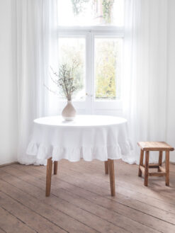 White round ruffled linen tablecloth