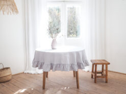 Light gray round ruffled linen tablecloth