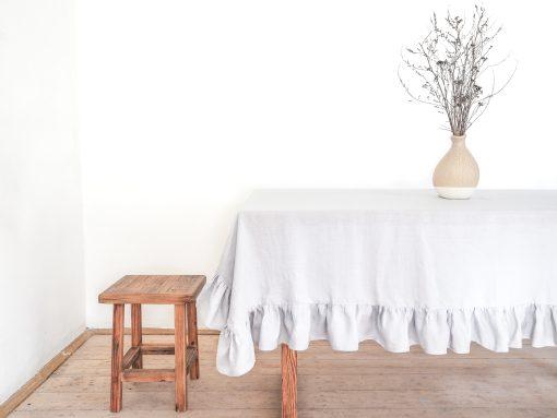 Light gray ruffled tablecloth