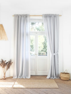 Light gray curtains with fringe