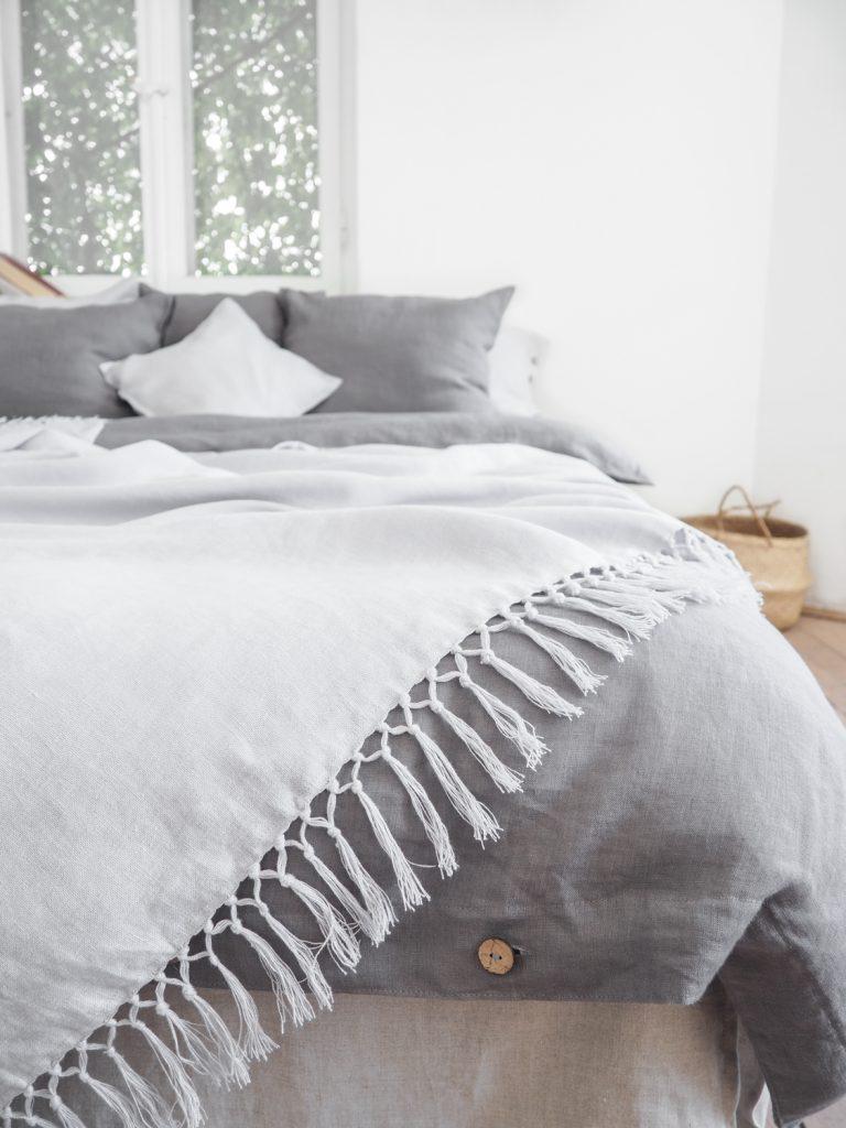 light grey linen blanket with fringes